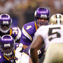 September 9, 2010; New Orleans, LA, USA; Minnesota Vikings quarterback Brett Favre (4) under center during first half of the NFL Kickoff season opener against the New Orleans Saints at the Louisiana Superdome. Mandatory Credit: Derick E. Hingle