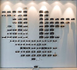 """SOLMS, GERMANY - MAY-18-2009 - The """"Leica Family Tree"""" display, in the lobby of Leica's HQ in Solms, Germany. (Photo © Jock Fistick)"""