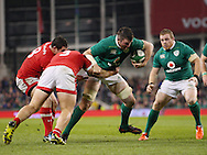 Peter O'Mahony of Ireland with the ball and Jake Ilnicki with Kyle Baillie of Canada during the 2016 Guinness Series  autumn international rugby match, Ireland v Canada at the Aviva Stadium in Dublin, Ireland on Saturday 12th November 2016.<br /> pic by  John Halas, Andrew Orchard sports photography.