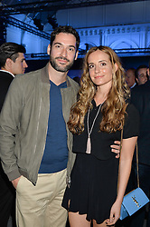 TOM ELLIS and MEAGHAN OPPENHEIMER at the Maserati Levante VIP Launch party held at the Royal Horticultural Halls, Vincent Square, London on 26th May 2016.