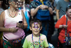 © Licensed to London News Pictures . 24/08/2019. Manchester, UK. HARRY MONAGHAN (nine from Bury) . The 2019 Manchester Gay Pride parade through the city centre , with a Space and Science Fiction theme . Manchester's Gay Pride festival , which is the largest of its type in Europe , celebrates LGBTQ+ life . Photo credit: Joel Goodman/LNP