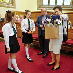 ** Exclusive **<br /> <br /> Princess Royal visits Kirk of Calder, Thursday 25th May 2017<br /> <br /> The Princess Royal visited Kirk of Calder in Mid Calder, Livingston today to accept a cheque on behalf of The Vine Trust.<br /> <br /> The Princess Royal is presented with flowers by 11-year-olds Daisy Stewart and Robyn McKissock who had taken part in a sponsored bike ride for the charity.<br /> <br /> £85,500 has been raised by members and organisations of the kirk to help fund an orphanage in Tanzania.<br /> <br /> There was an increased police presence due to the recent Manchester bombing.<br /> <br /> (c) Alex Todd | Edinburgh Elite media