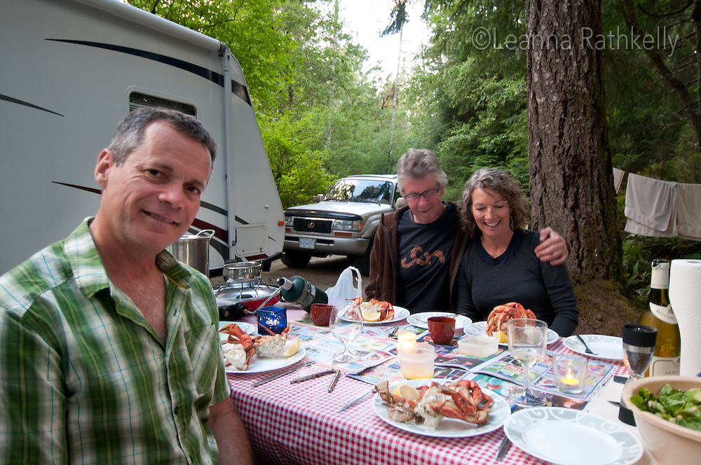 Campers tuck into a feast of Dungeness Crab, caught fresh off the coast of Campbell River, BC, while camping at BC Parks Elk Falls Provincial Park.