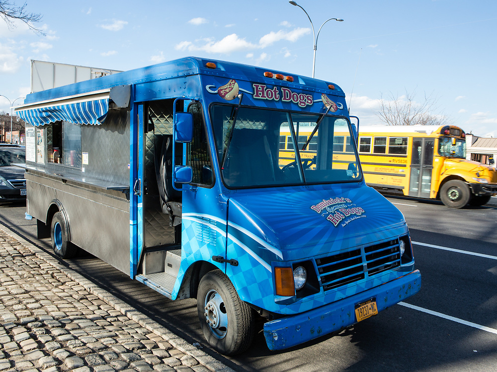 The step van of Dominick's Hot Dogs on Woodhaven Blvd. in Queens. The van was converted by 800BuyCart, and is the fourth identical van the company has outfitted for Dominick's. Refrigeration is provded by a holdover system, in which a coolant is supercooled overnight, and which keeps the contents cold throughout the day.