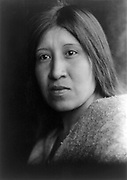 Head and shoulders portrait of Native Amerivan woman, c1924. Photograph by Edward Curtis (1868-1952).