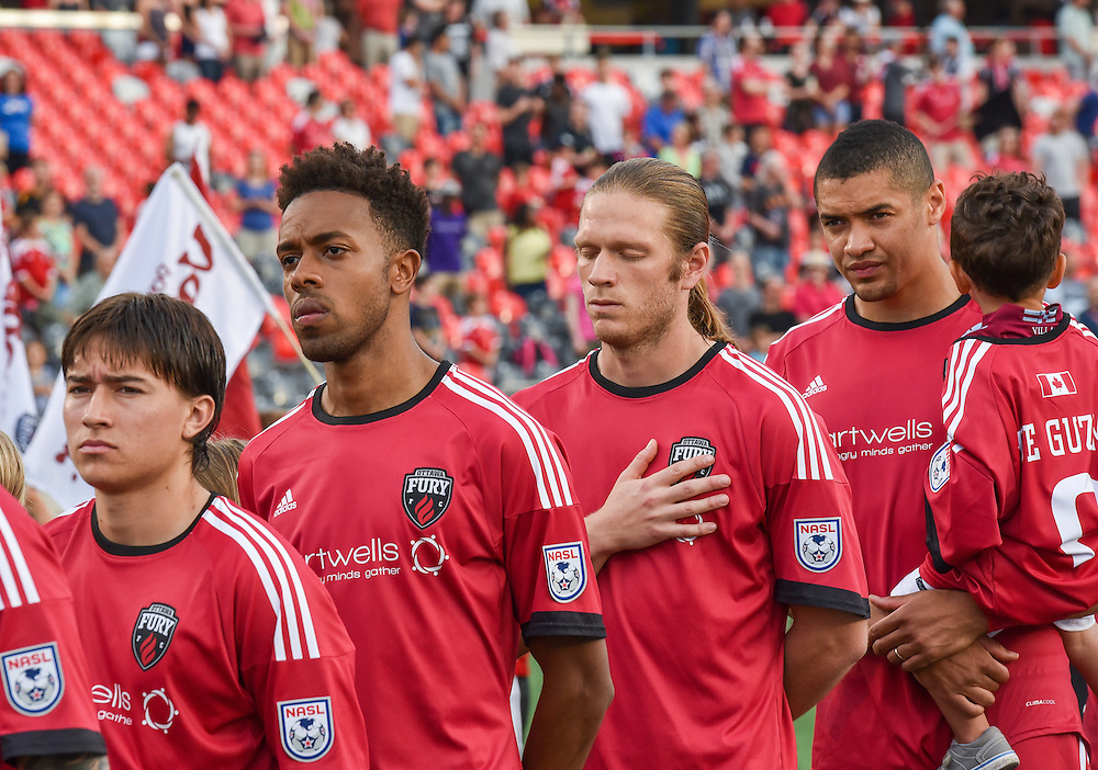 Ottawa Fury FC midfielder Bryan Olivera (#9),  forward Dennis Chin (#15), midfielder Lance Rozeboom (#25) and  defender Onua Obasi (#14) stand for the National Anthems before the NASL match between the Ottawa Fury FC and Fort Lauderdale Strikers at TD Place Stadium in Ottawa, ON. Canada on May 27, 2016. <br /> <br /> PHOTO: Steve Kingsman/Freestyle Photography
