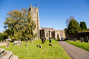 Church of Saint Andrew and gravestones in churchyard, Chew Magna, Somerset, England, UK