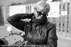 Sharon Jacobs at a gas stop during Stage 7 of the Motorcycle Cannonball Cross-Country Endurance Run, which on this day ran from Sedalia, MO to Junction City, KS., USA. Thursday, September 11, 2014.  Photography ©2014 Michael Lichter.