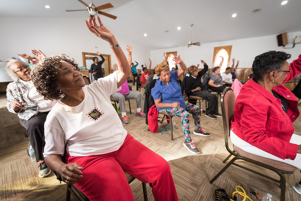 """6 December 2018, Charlotte, North Carolina, United States: Biweekly """"chairobics"""" session, aerobics for people with limited mobility, in the Rockwell African Methodist Episcopal Zion Church, Charlotte, North Carolina."""