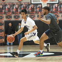 Miyamura's Jarron Cadman (15) dribbles down the court as Spring Valley's Michael Martin (5) defends at the Gallup Invitational boys basketball tournament Thursday, Jan 2 at Gallup High School.