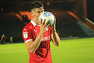 HAT-TRICK Kieffer Moore kisses the ball during the EFL Sky Bet League 1 match between Rochdale and Barnsley at Spotland, Rochdale, England on 21 August 2018.