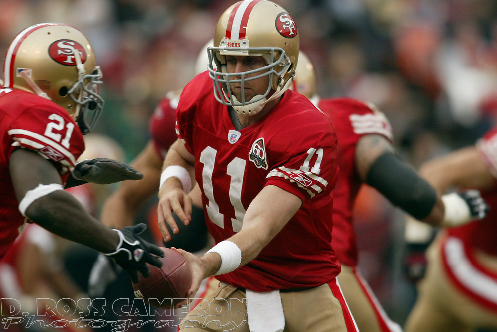 San Francisco 49ers quarterback Alex Smith (11) hands the ball off to running back Frank Gore during the third quarter of an NFL football game against the Arizona Cardinals, Sunday, Dec. 24, 2006 at Candlestick Park in San Francisco. The Cardinals won, 26-20. (D. Ross Cameron/The Oakland Tribune)