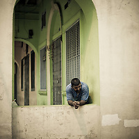 Man resting in archway, Little India, Kuala Lumpur