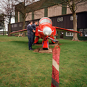 Small AIr Force cadet peers into ex-Gnat of the 'Red Arrows', Britain's Royal Air Force aerobatic team at RAF Scampton.
