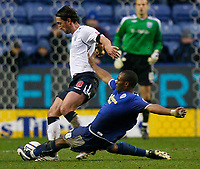 Photo: Steve Bond/Sportsbeat Images.<br /> Leicester City v West Bromwich Albion. Coca Cola Championship. 08/12/2007. Darren Kenton (R) slides in on Jonathan Greening (L)