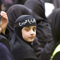Young muslim shiite woman  wearing hijab, ashura celebrations in Glasgow, Scotland<br />