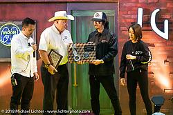 Dale Snoke gives his award at the 27th Annual Mooneyes Yokohama Hot Rod Custom Show 2018. Yokohama, Japan. Sunday, December 2, 2018. Photography ©2018 Michael Lichter.