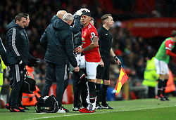 Manchester United's Marcos Rojo (centre) has bandage applied to his head after picking up an injury