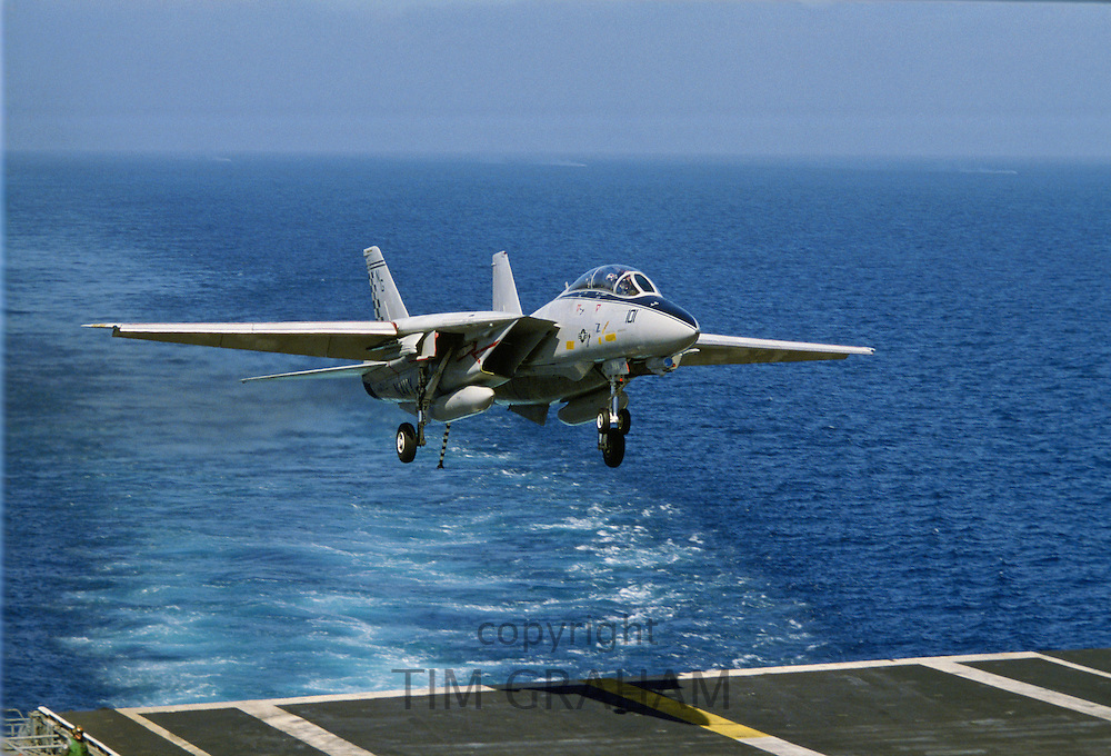 Military airplane returns to USS Nimitz aircraft carrier, Los Angeles,  USA.
