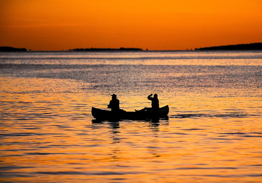 Sunset canoeing, Martha's Vineyard, Cape Cod, Massachusetts, USA