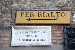 Direction sign towards the Rialto Bridge in Venice Italy