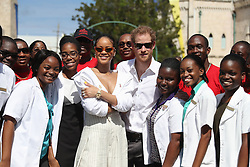 Prince Harry and Rihanna pose with volunteers during the 'Man Aware' event held by the Barbados National HIV/AIDS Commission in Bridgetown, Barbados, during his tour of the Caribbean.