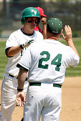 21 April 2007: Ricky Angel rounds 3rd base and gets a high five from his coach Dennis Martel for his homerun.  Carthage College loses the first game of a double header by a score of 5-2 against the Illinois Wesleyan Titans.