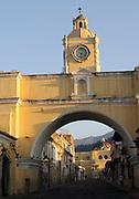 Arco de Santa Catalina, the Saint Catalina Arch, from the south looking towards the church of  La Merced up 5 Avenida Norte.  Antigua Guatemala, Republic of Guatemala. 02Mar14