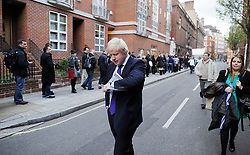 London Mayor Boris Johnson walks through the streets of London on his way to the Mayoral debate with the other Mayoral Candidates, moments before going on stage, London, Wednesday April 11, 2012. Photo By Andrew Parsons/i-Images