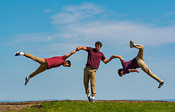 Pictured: Edinburgh Festival Fringe, Edinburgh, Scotland, United Kingdom, 30 July 2019 . Photocall for the return of award-winning Barely Methodical Troupe, an experimental acrobatic circus, who perform feats of strength, circus skills, hand-to-hand balancing and acrobatics in their 2019 fringe show 'Bromance', previously their debut show, which explores the friendship between three acrobats – Louis Gift, Cyr wheeling star Charlie Wheeller and flying trickster Beren d'Amico with the backdrop of the city skyline from Calton Hill.<br /> Sally Anderson | EdinburghElitemedia.co.uk