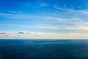 Nederland, Friesland, Harlingen, 28-02-2016; de Afsluitdijk gezien vanaf de Waddenzee ter hoogte van Harlingen. Links de Friese kust en Kornwerderzand.<br /> Enclosure Dam as seen from the Wadden Sea at the height of Harlingen. Left the Frisian coast and Kornwerderzand.<br /> <br /> luchtfoto (toeslag op standard tarieven);<br /> aerial photo (additional fee required);<br /> copyright foto/photo Siebe Swart