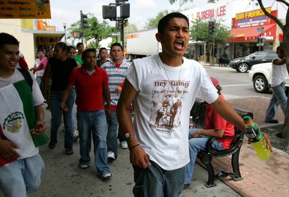 """Photo by Alex Jones..Chanting """"Mexico, Mexico,"""" Raul Segovia and approximately 30 other McAllen High School students march down 16th Street in downtown McAllen on Friday afternoon.  The students said they walked out of McAllen High School and to the Mexican consulate to protest proposed the proposed immigration reform laws currently in congress."""