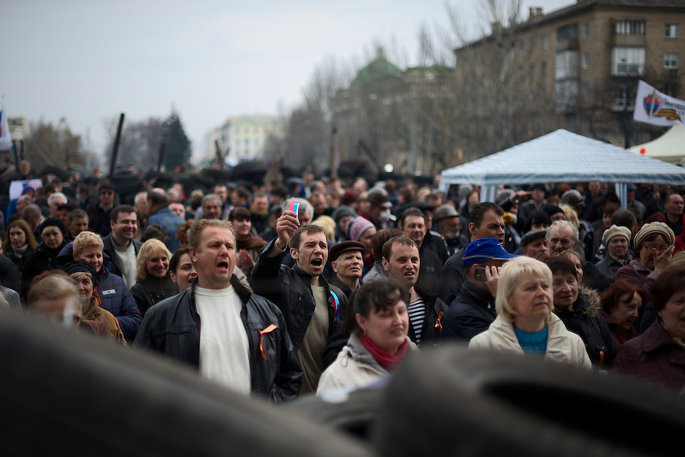 Pro-Russia protestors chant words of support to activists occupying the Donbass Regional Government building in central Donetsk. Barricades around the building, occupied since the past weekend, have been fortified throughout the day, as the ultimatum given by the government in Kiev for the activists to abandon the building within 48 hours, is approaching its deadline.