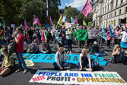 Climate activists from Extinction Rebellion occupy roads around Parliament Square during a Back The Bill rally on 1st September 2020 in London, United Kingdom. Extinction Rebellion activists are attending a series of September Rebellion protests around the UK to call on politicians to back the Climate and Ecological Emergency Bill (CEE Bill) which requires, among other measures, a serious plan to deal with the UK's share of emissions and to halt critical rises in global temperatures and for ordinary people to be involved in future environmental planning by means of a Citizens' Assembly.