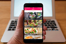 Using iPhone smartphone to display Foodora home takeaway food delivery service
