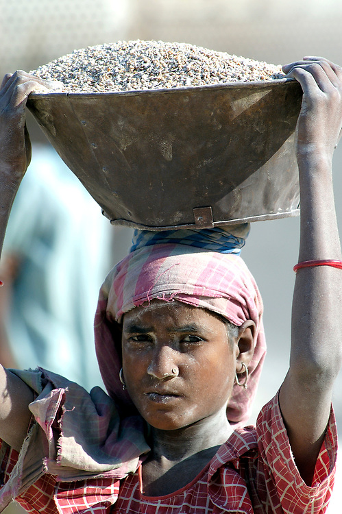 A girl at work in a gravel quarry in northeast India. Child labor is a problem throughout India and many other developing countries.