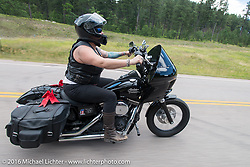 Angela Erfman on the Annual Cycle Source and Michael Lichter Rides (combined this year) left from the new Broken Spoke area of the Iron Horse Saloon during the Sturgis Black Hills Motorcycle Rally. SD, USA.  Wednesday, August 10, 2016.  Photography ©2016 Michael Lichter.
