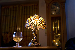Wineglass with illuminated electric lamp made of amber