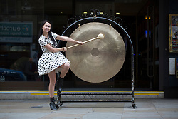 © licensed to London News Pictures. London, UK 22/11/2012. Kate Holderness, the winner of new Rank films 'Gongman', banging a gong outside Grosvenor G Casino in London. Photo credit: Tolga Akmen/LNP