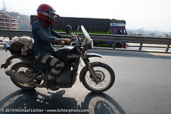 Danita Gayle riding a Royal Enfield Himalayan on Motorcycle Sherpa's Ride to the Heavens motorcycle adventure in the Himalayas of Nepal. Riding from Daman back to Kathmandu. Wednesday, November 13, 2019. Photography ©2019 Michael Lichter.