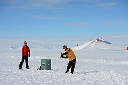 """© Licensed to London News Pictures. Union Glacier, Antarctica. PETER JOUBERT resident of Perth, Australia batting. Competitors from the Antarctic Ice Marathon play a game of impromptu """"Ashes"""" cricket at the Union Glacier camp, Antarctica ahead of the 2013 Antarctic Ice Marathon, which takes place  just a few hundred miles from the South Pole at the foot of the Ellsworth Mountains.. The majority of players were either Australian and English. It was declared a sporting draw. Photo credit: Mike King/LNP"""