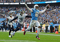 American Football - 2018 NFL Season (NFL International Series, London Games) - Tennessee Titans vs. Los Angeles Chargers<br /> <br /> Tyrell Williams of the Los Angeles Chargers runs clear to score his touchdown with Kevin Byard unable to catch him, at Wembley Stadium.<br /> <br /> COLORSPORT/ANDREW COWIE