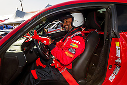 """LONG BEACH, CA - APRIL 07 Actor Alfonso Ribeiro a two-time Toyota Pro/Celebrity race winner (1994 & 1995). Best-known for his role as 'Carlton' on """"Fresh Prince Of Bel Air,"""" Last season Ribeiro took home the coveted Mirror Ball Trophy on """"Dancing With The Stars."""" at the 2015 Toyota Celebrity/PRO Press/Media Day in Long Beach, CA. 2015 April 7. Byline, credit, TV usage, web usage or linkback must read SILVEXPHOTO.COM. Failure to byline correctly will incur double the agreed fee. Tel: +1 714 504 6870."""