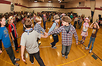 Cole Westoner and Andrew Goodearl lead their group in the right hand star during Inter Lakes Elementary School's annual Square Dance Thursday afternoon.  (Karen Bobotas/for the Laconia Daily Sun)