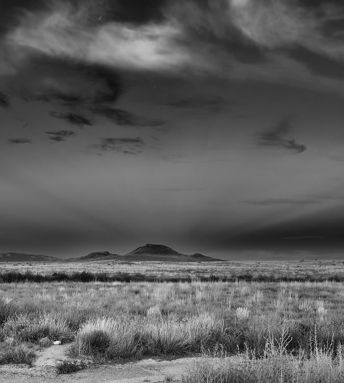 Vulcan, named after the Roman god of fire, is an inactive volcano on Albuquerque, New Mexico's West Mesa. Seen at sunset from afar.