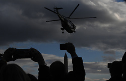 Guests make video with their iphones as Marine One takes of with President Donald Trump, First lady Melania Trump and son Barron Trump onboard in Washington, DC on November 20, 2018. Photo by Olivier Douliery/ABACAPRESS.COM