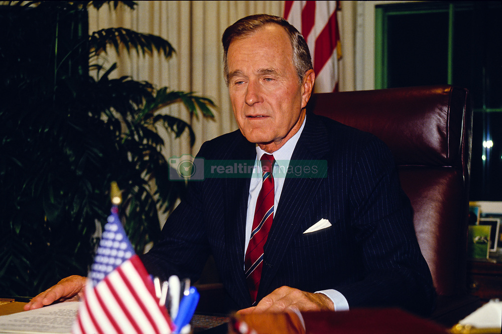 United States President George H.W. Bush poses for photographers after delivering an address to the nation on the budget compromise in the Oval Office of the White House in Washington, D.C. on October 2, 1990. Photo by Howard L. Sachs / CNP /ABACAPRESS.COM