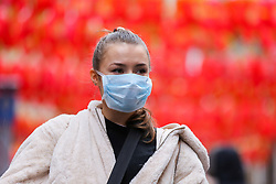 © Licensed to London News Pictures. 26/01/2020. London, UK.  A woman in Chinatown in central London is seen wearing a face mask following the outbreak of Coronavirus in China which has killed 41 people. Photo credit: Dinendra Haria/LNP