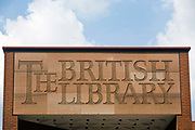 Stone signage above the gateway of the British Library. London, UK