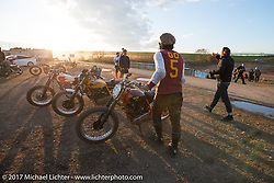 Go Takamine as the sun goes down after a day of Brat Style flat track racing at West Point Offroad Village. Kawagoe, Saitama. Japan. Wednesday December 6, 2017. Photography ©2017 Michael Lichter.
